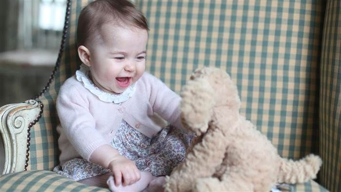 Princess Charlotte of Cambridge with her cuddly toy dog