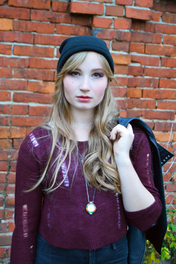 Rock outfit with crop sweater, leather jacket and vintage watch. Fashion photoshoot.