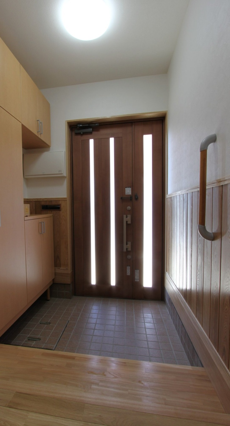 Typical Japanese door with handle and genkan | Japanese