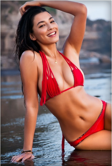 Australia was all about Red. Jessica Gomes rocks this Acacia swimsuit with simple gold and neutral jewelry.