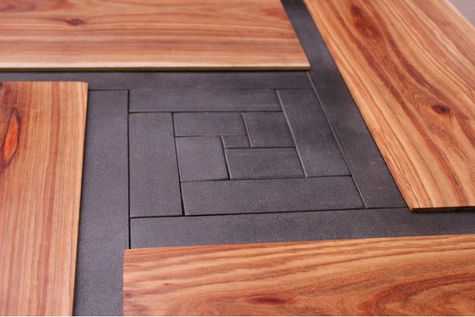 Detail view on the Solid Kiaat parquet coffee table by JVS Designs  If you love woodgrain and parquet patterns, you'll love the unique look of this table