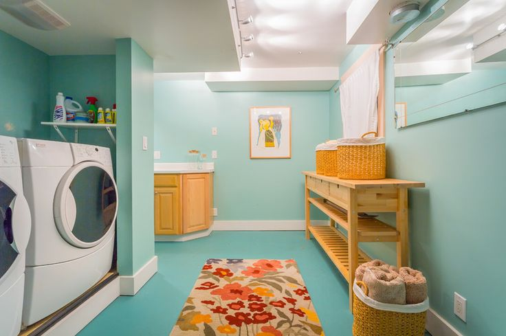 Like the use of the rug in room.  beach style laundry room by Cassie Daughtrey Realogics Sotheby's Realty