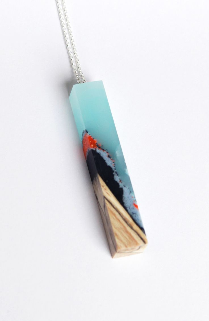 Designer: Ejing Zhang Rectangular flat pendant on delicate silver chain. Handcrafted process with materials: threads, wood and resin. Size: 65 cm silver chain, pendant 7x1,2x1,5 cm Material: Beech wood, resin, thread Collection: Moonrise