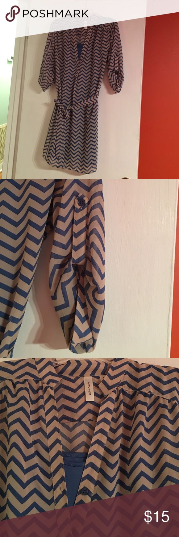 Size medium slightly worn chevron dress. Slightly worn blue and cream chevron dress with sleeves as shown in pictures. Has a belt at waist. From smoke free home. Dresses