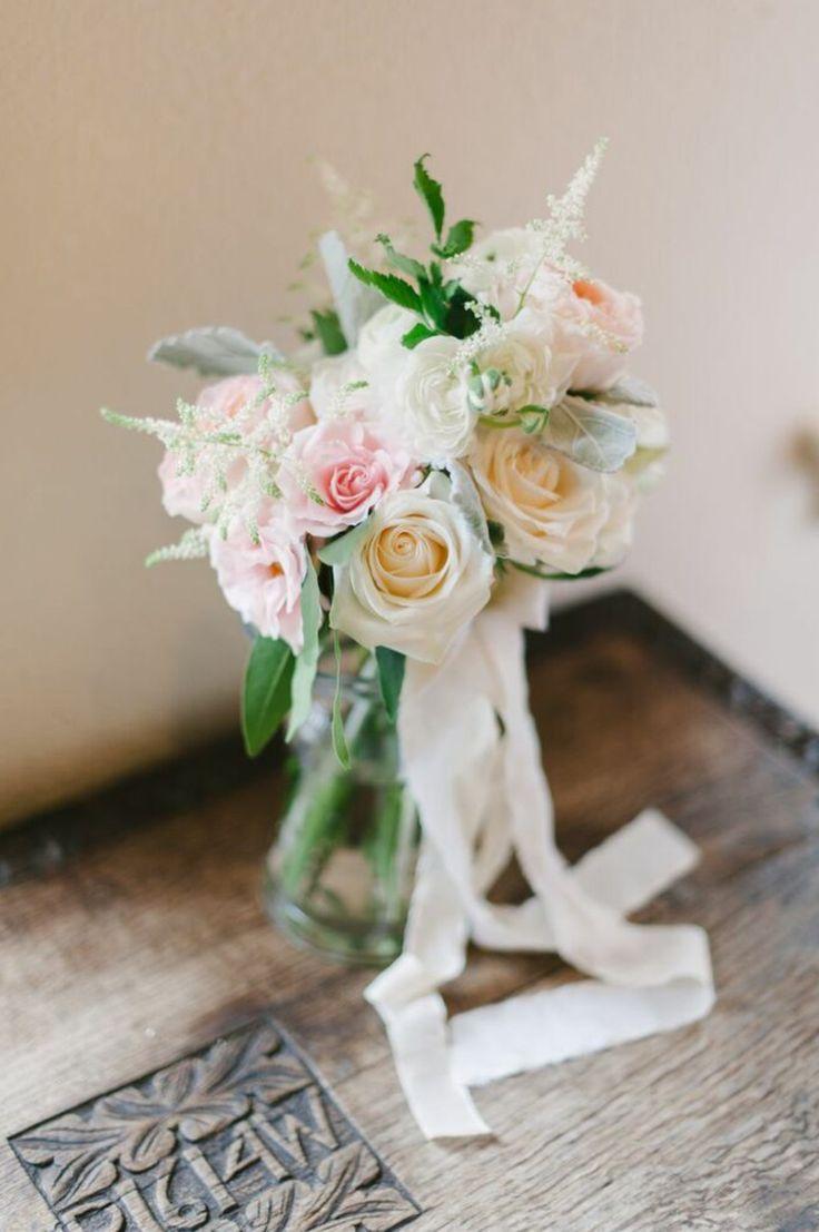 bridesmaid bouquet of peach juliet garden rose, white o'hara garden rose, pink majolik spray roses, white ranunculus, vendela roses, white astilbe, dusty miller & bay leaf wrapped in silk ribbons