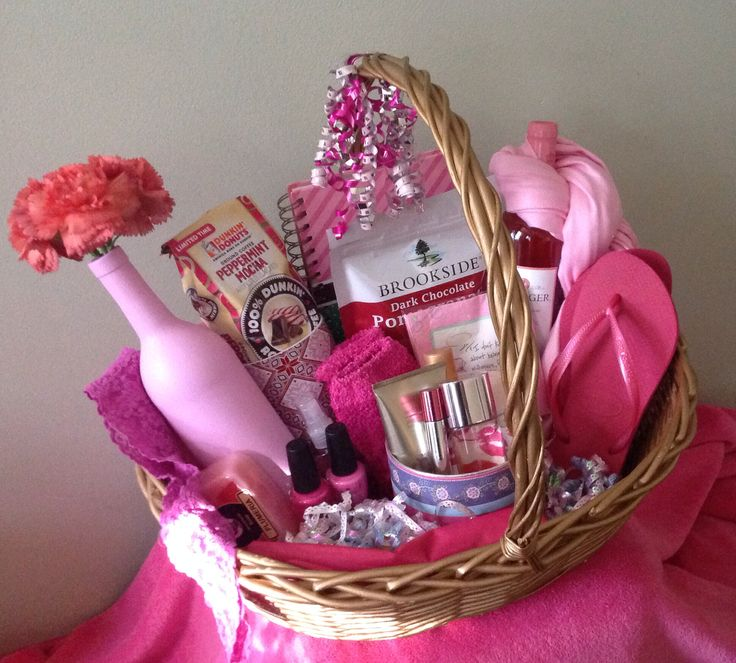"""The """"All Things PINK"""" gift basket! This could be given to women of all ages & it is so fun and whimsical! Gift basket includes Wine, a pink wine vase, a mug with coffee grounds, lotion, napkins, perfume, nail polish, soap,hanky pankys, a scarf, a journal, havaianas, lip gloss, and choc. covered pomegranate!  Contact: yourfavoritethings7@gmail.com if you would like to order your own gift basket! https://www.facebook.com/pages/Your-Favorite-Things-Custom-made-gift-baskets/1398610010441823"""