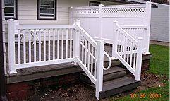 vinyl railing with ADA handrail by Elyria Fence