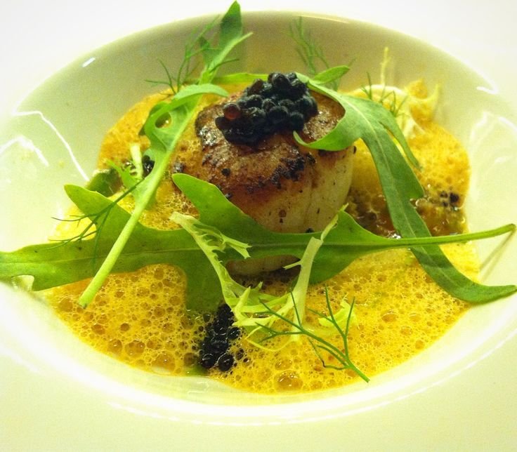 US Scallop, wild rocket, prawn stock quinoa, bisque broth and balsamic pearls.