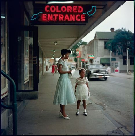 """""""Department Store, Mobile, Alabama"""" (1956) documents the era of segregation, with separate entrances for blacks and whites. Photo: Gordon Parks"""