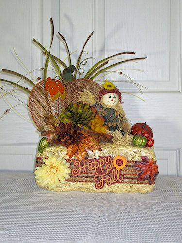 Fall Floral Arrangement Hay Bale With Scarecrow Sitting