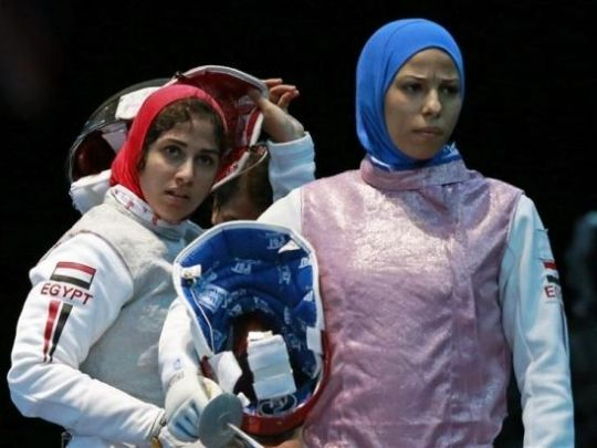 Hijabi athletes at the London Olympics, fencers for Egypt.