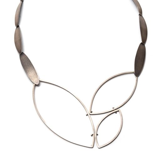 Owen McInerney - Fabricated sterling silver statement necklace features 3 leaf silhouettes and roller printed petal links.    OUT ...