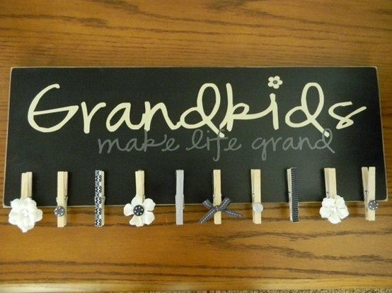 How cute if you used this to display each grandchilds yearly school pictures,,,I'll beed a few more clothespins on mine ;)