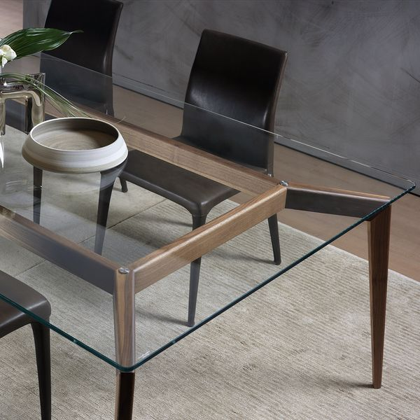 Hope is an elegant dining table range designed by Cesare Arosio and made in Italy by Pacini e Cappellini. The glass top extends over a solid wood base in walnut...