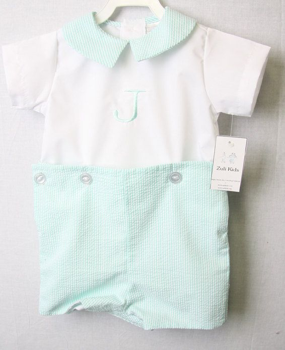Our personalized baby boy button-on outfits are perfect for pictures, holidays or any special occasion. Our baby boutique clothing store offers toddler boy clothes in many styles and colors. Our Boutique Clothing is a perfect option for matching or coordinating twin baby outfits or sibling outfits. Please contact us with any questions.  This Baby boy button-on is shown in Aqua seersucker button on pants and an aqua seersucker collar and monogramed in aqua. Can come plain or with monogram. If…