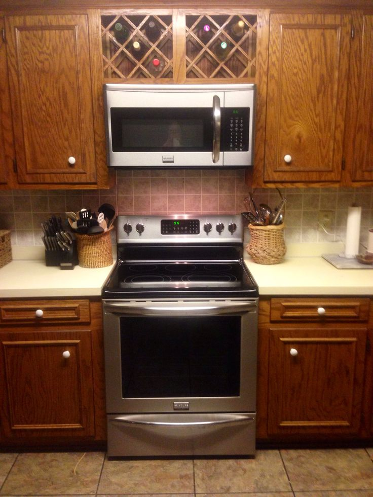 Over the counter microwave and wine rack.
