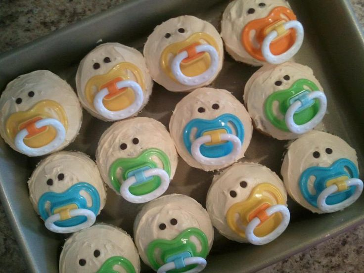 SUPER EASY Baby Shower Cupcakes!  Bake cupcakes, use a buttercream frosting (add 1 drop of red & yellow food coloring for more of a peach tone) Place MINI chocolate chips for the eyes - and pop in a pacifer for the mouth!