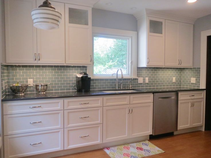 Starmark Cabinetry with a painted Marshmallow Cream tinted varnish ...