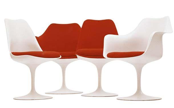 CADEIRAS8 design de cadeiras poltrona  branca Com uma forma vanguardista para a época, a cadeira Tulipa, foi criada pelo Eero Saarinen como alternativa ao mobiliário com muitas pernas, toda a sua beleza é sustentada por um pedestal minimalista.