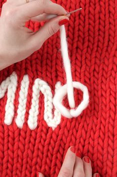The easy way to put on names, mottos, etc: Chain stitch embroidery over plain knitting