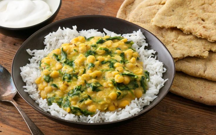 A comforting Indian spinach dal recipe of yellow split peas and spinach flavored with butter infused with cumin, turmeric, garlic, ginger, and serrano chile.