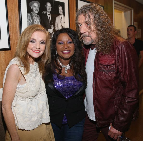Robert Plant and Patty Griffin Photos - Patty Griffin, Regina McCrary, and Robert Plant pose backstage at the 13th annual Americana Music Association Honors and Awards Show at the Ryman Auditorium on September 17, 2014 in Nashville, Tennessee. - Americana Music Festival Show