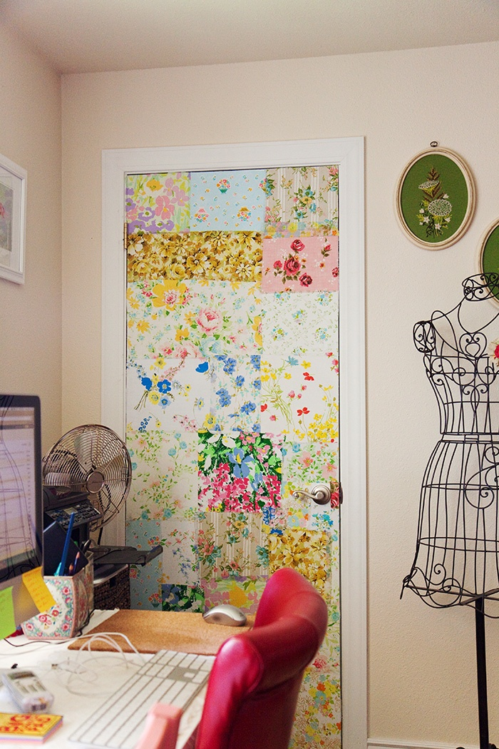 in the studio, vintage fabric covers a boring (not anymore) white door.