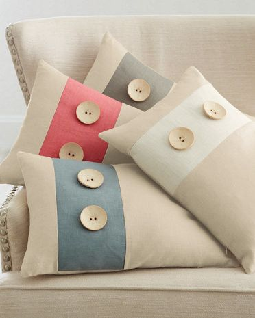 As cute as a button — times two! With its classic colors and sewn-on oversized wooden buttons, this handmade-in-the-USA linen pillow has a retro look that is totally at home on any sofa, chair, or bed. Hand-cut and hand-sewn. Hidden zipper closure. Linen. USA.