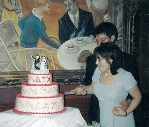 Here we are cutting into it...can you believe this cake was $500? And we had only 45 people.....