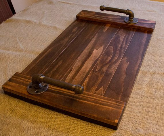 The Rustic Wood Serving Tray with Industrial Galvanized Pipe Handles is handmade from Complex Ideas. Ideal for everyday serving needs or