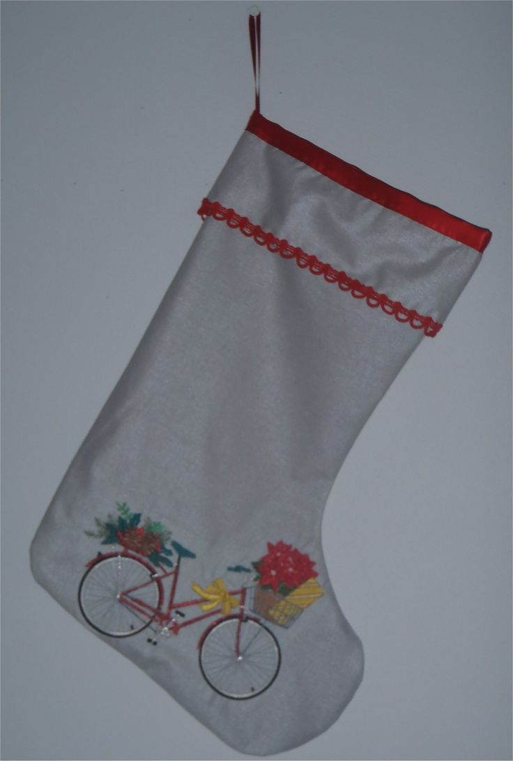 201655 - Christmas stocking.  Machine embroidered bicycle on silver fabric.  Red trim and lining. SOLD. Can be ordered