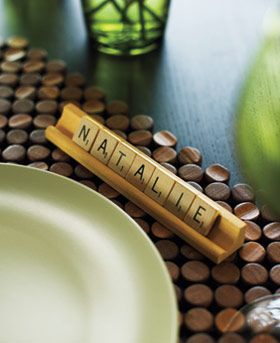 Scrabble placecards! Such a cute idea!! I wonder if you could find scrabble letters and holders online somewhere cheap? I wouldn't wanna have to buy the whole game ...