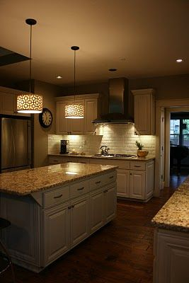 Real kitchens; note pendant lights and granite kitchen counters.