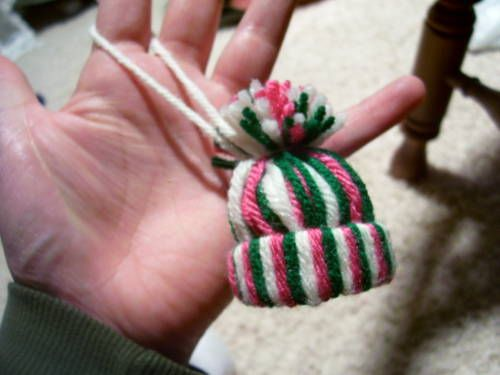 Yarn Stocking Cap Tutorial - so cute and easy to make.  Great for kids to make to adorn your Christmas tree or presents...