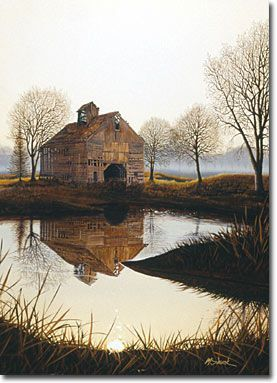 Old barn with a beautiful pond reflection: