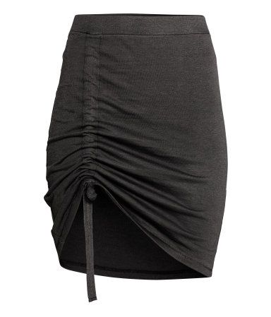 Dark grey. Short, fitted skirt in soft jersey with an elasticated waist and diagonal drawstring.