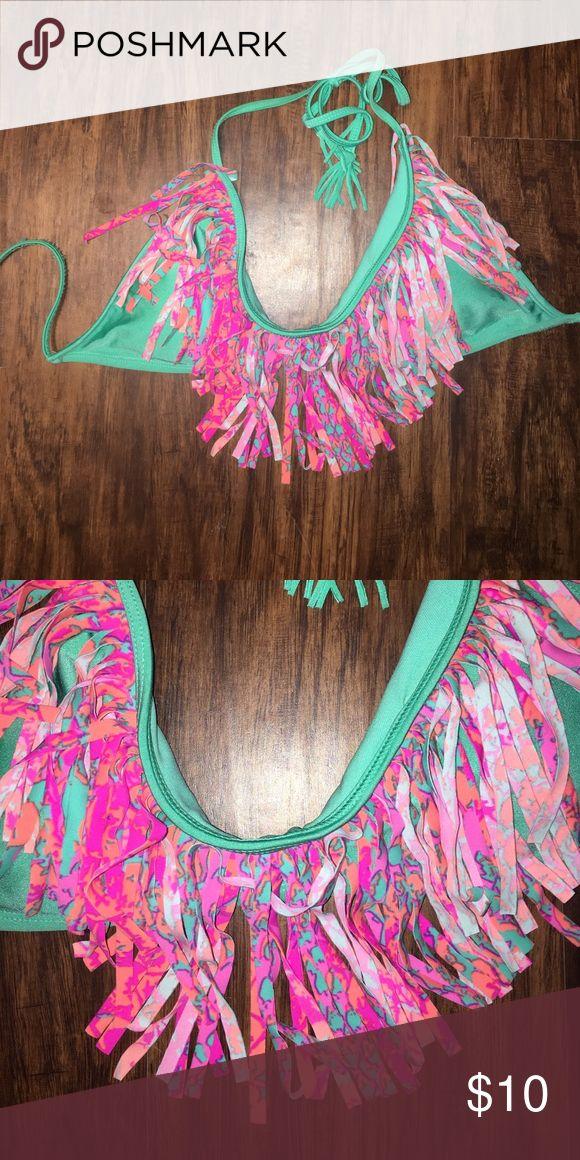 Raisins fringe bathing suit top Raisins teal bathing suit top with pink and orange fringe. Size large. Price reflects wear. Raisins Swim Bikinis