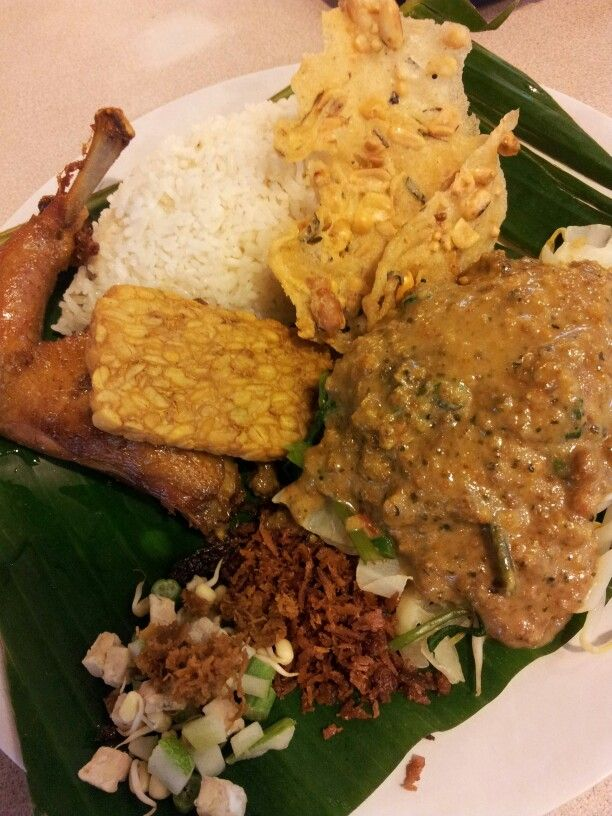Nasi Pecel. Famous Indonesian food from Javanese. Served with rice, mixed vegetable with peanut paste and  fried chicken