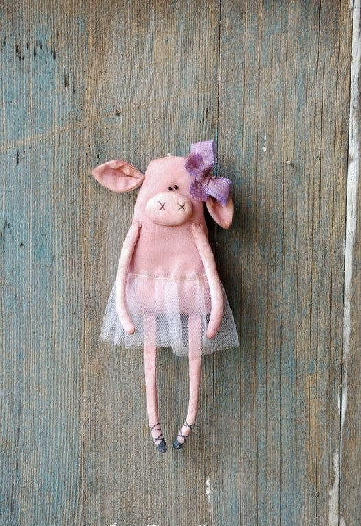 This cute little piggy ballerina has been sewn of 100% cotton and filled with polyester fiber fill. She has been stained with coffee and cinnamon and painted with acrylics. She has beads for eyes. She has a loop behind for hanging. She is wearing a purple tutu skirt and a bow