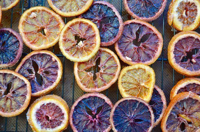 "#CandiedBloodOrangesRecipe. ""The deep colour they turn once they're candied always come off as moody and brooding. If fruits had moods, and personalities. Which clearly they do."" https://loom.ly/8_r8hy4"
