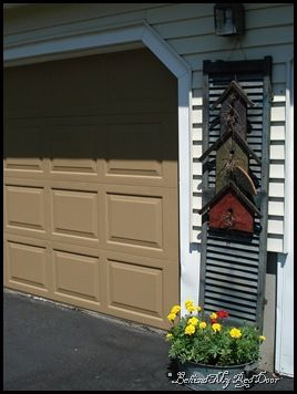 Sweet birdhouse decorative shutter for by a garage ~ love this look!