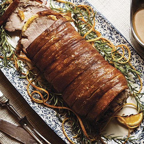 Pork is especially popular in Denmark, where it's the centerpiece of our Christmas table. Be sure to offer everyone some of the fragrant onion-orange stuffing and crunchy crackling along with their slices of juicy pork. The unusual gravy gets its deep sweet-and-savory flavor from homemade stock, the roast drippings, creamy Danish blue cheese, and red currant jelly. This dish is equally good cold the next day, on rye bread with a sprinkle of coarse salt and leftover braised cabbage.