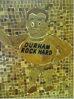 "A manual arts teacher in Phoenix had his students make wooden ""mosaic"" pictures using various varieties of wood scraps. They would cut scraps to the correct shape and thickness, attach them to a piece of plywood using white glue, sand it even, grout it with Durham's Water Putty, and then sand once again. The resulting mosaic scenes were finished with several coats of a polyester finish, and then waxed with a carnauba wax. #Durham's #Durhams #WaterPutty #Mosaic #Art #Plaque"