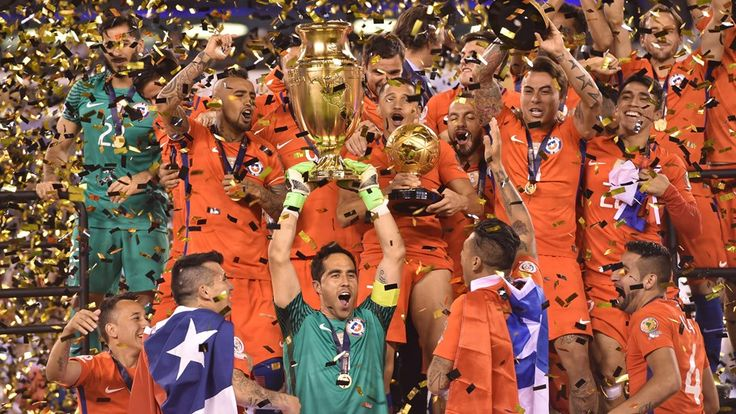 Chile's goalkeeper Claudio Bravo holds the trophy after winning the Copa America Centenario final