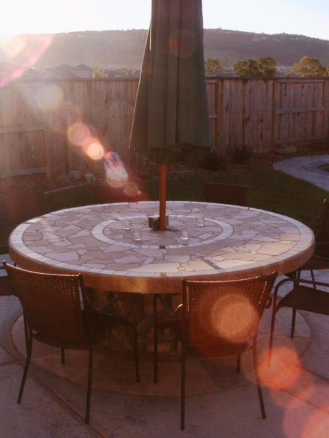 King Arthurs Spool Table, This project started out with a giant wooden spool. We poured the patio with a hole in it (for the table--the hole...