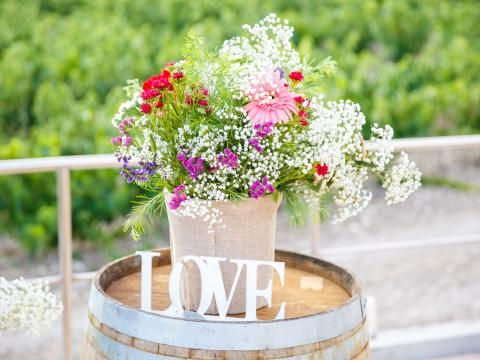 Winery wedding in Cyprus, barell and simple flowers