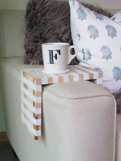 Even if you've got an abundance of side tables, it can be nice to have a place to hold your drink immediately at-hand. Francois et Moi's striped wooden drink perch fits neatly over the arm of your sofa, and is a great project for first-time woodworkers (there are detailed instructions on her site).