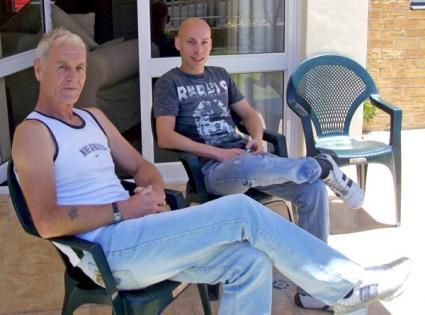 DJ Michael Angello (left) sat with The Dream House Crew (Right)