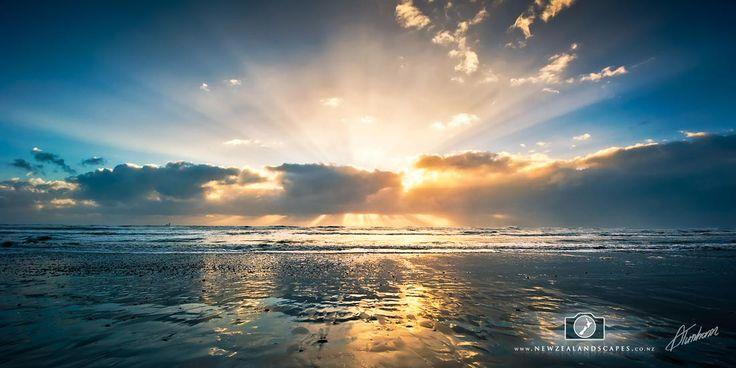 Sun bursting through the cloud on a West Coast Beach