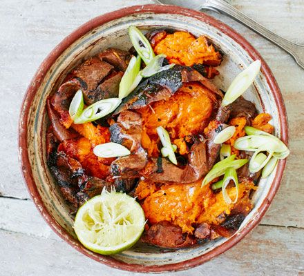 A barbecue twist on conventional sweet potato mash with smoky skins, spring onions and a squeeze of lime